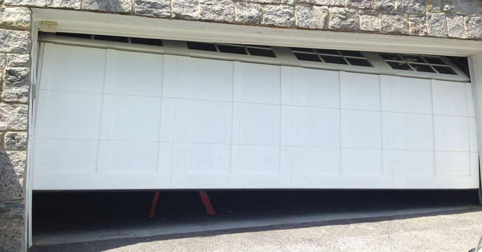 Broken garage door repairs Menomonee Falls